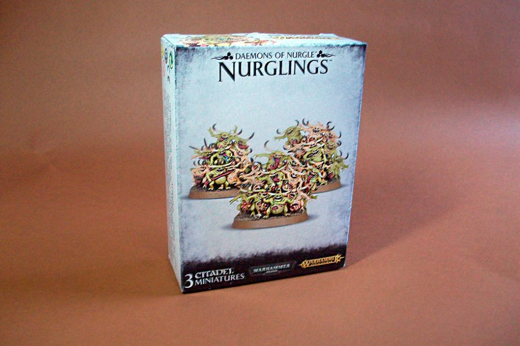 Angle view of Nurglings box on a brown background 2017